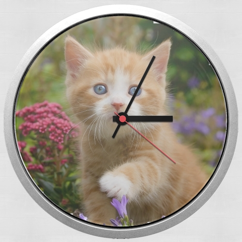 Cute ginger kitten in a flowery garden, lovely and enchanting cat for Wall clock