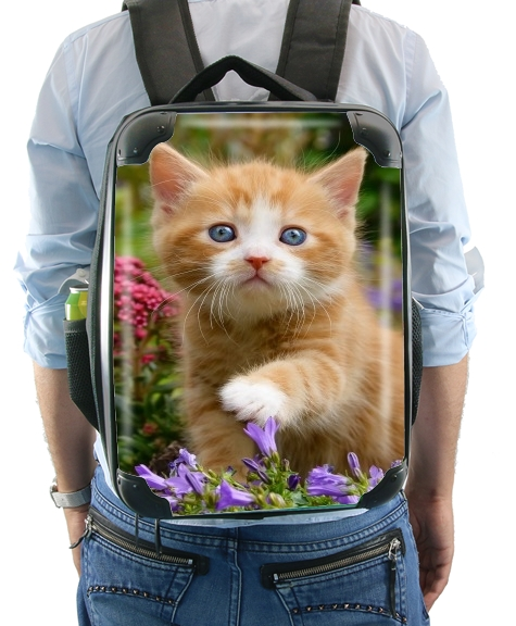 Cute ginger kitten in a flowery garden, lovely and enchanting cat for Backpack