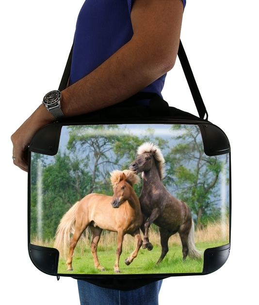 "Two Icelandic horses playing, rearing and frolic around in a meadow for Laptop briefcase 15"" / Notebook / Tablet"